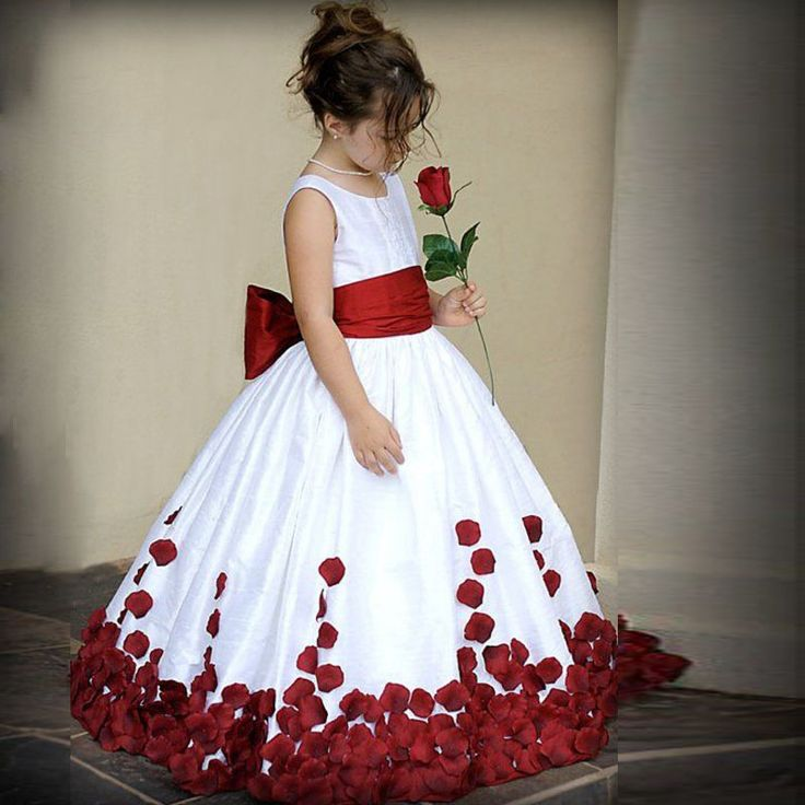 Adorable dress for my flower girl(s). Like my bridesmaids, the upper portion will feature an off-white, lace pattern and the lower portion will be rose gold. The flower petals will be various shades of pale pink, blue, and purple colors along with gold which will also be the color of the bow.