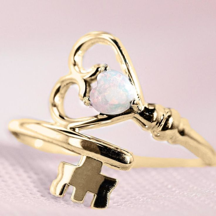 This Key To Her Heart ring is so enchanting it could have come straight from a fairytale. Customize the unique wraparound key band in your choice of silver, white gold, yellow gold or white gold. Select a birthstone or your favorite color for the sparkling heart shaped gemstone in the center. Beautiful as a promise ring, friendship ring, or simply a glamorous addition to your jewelry collection. No matter how you customize it, this ring will surely unlock the key to her heart.