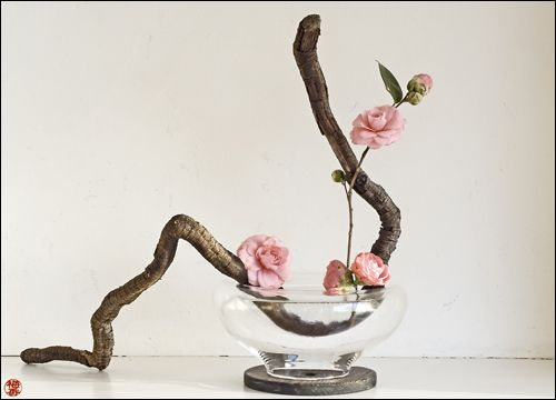 If you're not familiar with Ikebana, the Japanese art of flower arranging, then you're in for a treat. Ikebana is nothing like the traditional flower arrangements you might find at weddings or funerals, or wherever else flowers are displayed. Instead, these flower arrangements are more like organic sculptures, made up of living flowers, stems, and branches to form free-flowing works of three-dimensional art.
