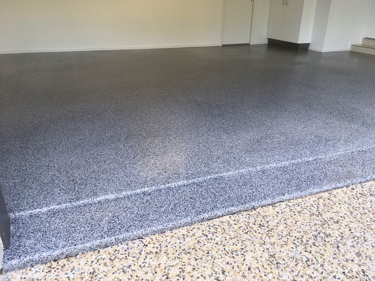 This is The Garage Floor Co.'s Graphite epoxy flake on a Pipeline grey base coat. It looks amazing! Call us on 0424 320824 for a free quote.