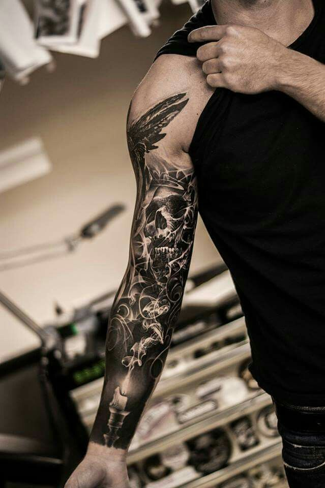 Skull smoke arm sleeve tattoo
