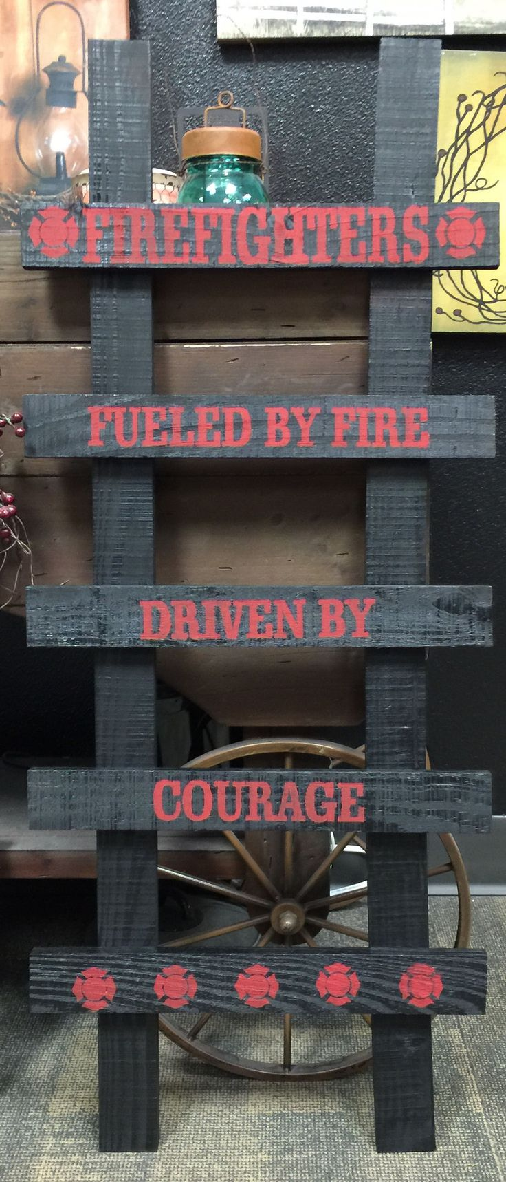 "Firefighter Ladder Sign: FIREFIGHTERS FUELED BY FIRE DRIVEN BY COURAGE Size: 12"" x 36"" Color: Black with Faded Red Font Made to Order and Ships in US Within 21 Days"