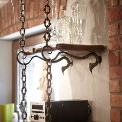 A wrought iron cellar shelf