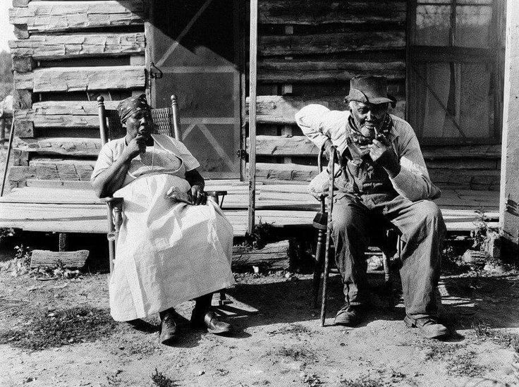 An older couple rest at the end of a workday on a plantation, most lived in the south but these were in Tennessee.. as you can see its a terrible & very hard life.. 1919