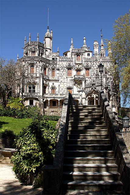 "Quinta da Regaleira is an estate located near the historic center of Sintra, Portugal. It consists of a palace and chapel, and a park featuring lakes, grottoes, wells, benches,  & fountains. The palace was also known as ""Palace of Monteiro the Millionaire"", from the nickname of its first owner, António Augusto Carvalho Monteiro. After being closed up for many years, it was aquired by the Sintra Town Hall & opened to the public."