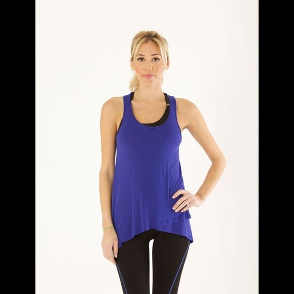 Electric Yoga Royal Blue Loose Tank Top SKU 6RS108 Item Name: Electric Yoga Loose Tank Top, Sizes In Pack: 1 Large, Suggested Retail Price:$72.00 Material Content: 97% Rayon, 3% Spandex, Made in: USA Electric Yoga Tops Tank Tops