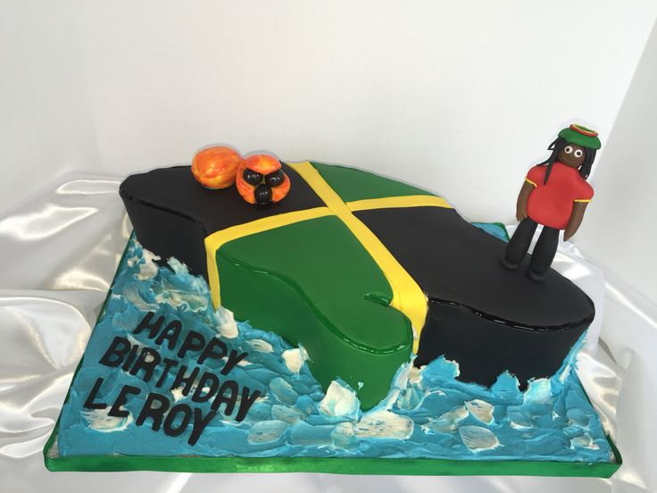 Jamaica Birthday Cake: map of Jamaica covered with the flag colors surrounded by the Caribbean Sea.#jabirthdaycakes#jaflagcakes#ackee#rastacakes#divinetreatsllccakes#cakes