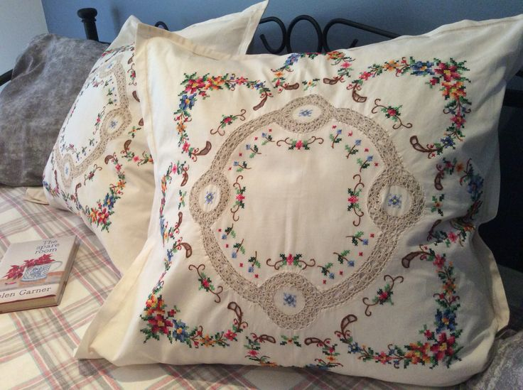A pair of European pillow covers made from matching vintage tablecloths.
