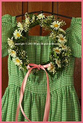 EARLY GREEN GINGHAM DRESS WITH DRIED FLOWER WREATH.