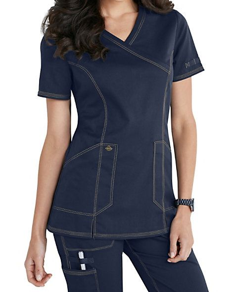 THE DELIGHT'S IN THE DETAILS There are too many details to list in Dickies Essence mock wrap tops! Front princess seams add shape and terminate in two slits in the front for maneuverability. These women's solid scrub tops feature Dickies logo camo print facing on the inside back, plus details like grommets and a printed utility loops in one pocket and on one sleeve. Pocketing includes two angled patch pockets with an instrument pocket that's perfect for scissors. Dickies Essence Mock ...