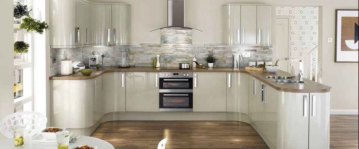 Howdens kitchen with American pecan worktop and floor.