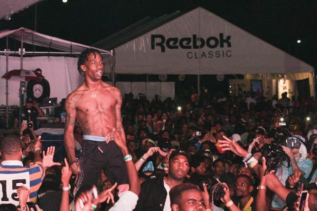 Rapper Travis Scott shirtless performing during the Trillectro Music Festival in August 2014...