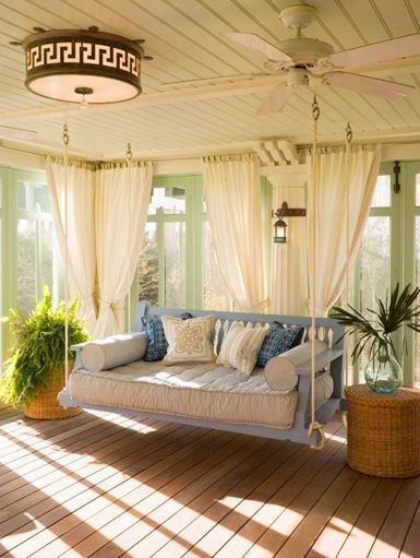 This bench swing full of pillows makes for a stunning hanging reading nook. The bright natural light and gauzy curtains lend the room a lovely romantic feel.