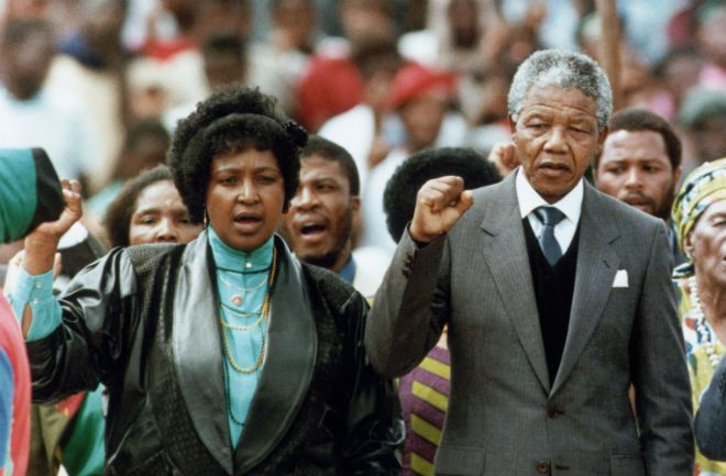 Mandela and his wife, Winnie, attend a rally after his release from prison. With his once-banned political party able to participate in elections, Mandela began the process of negotiating the end of apartheid with South African leadership.
