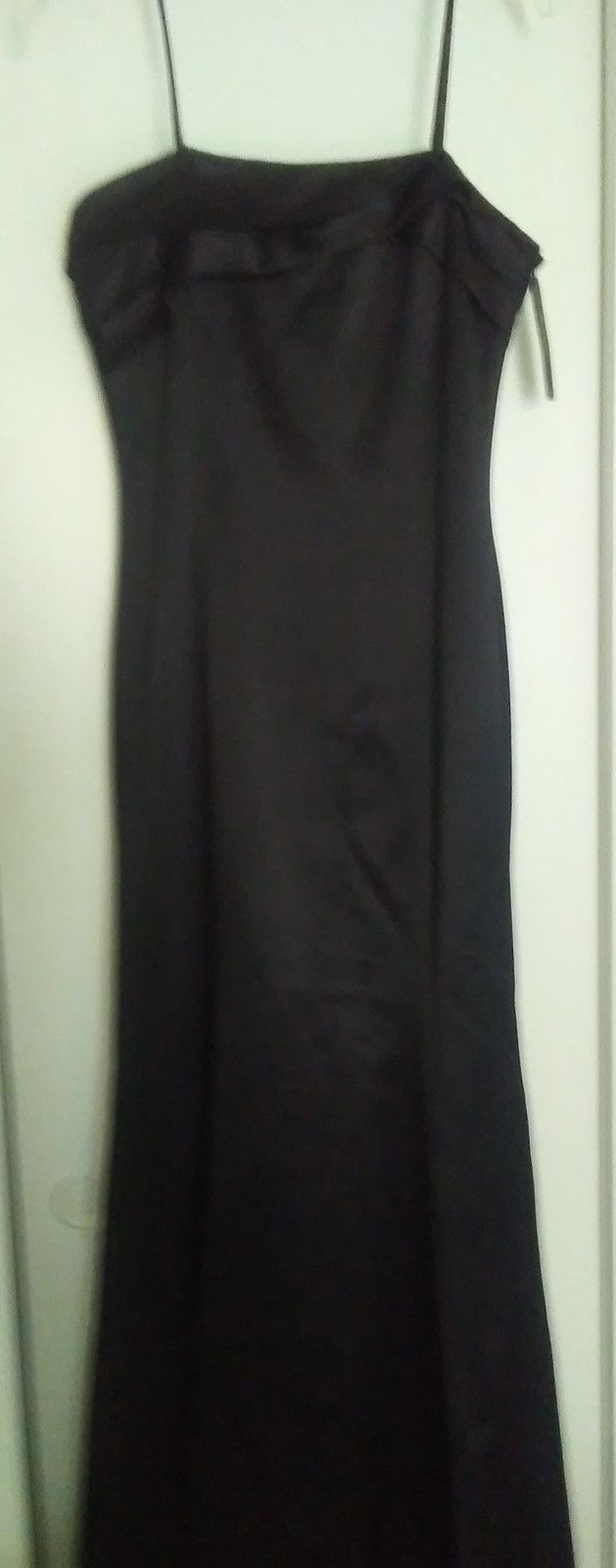 Womens Long Black Dress Formal Gown  Brand Specifics:  Sherri Segal formal Black satin dress. Long and shimmery. Fully lined. Spaghetti Straps. Maxi. Polyester/Satin. Great prom dress or evening gown in perfect condition. Pre-owned. Never worn....