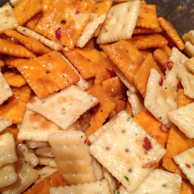 Fire Crackers, you won't be able to stop eating them! 1 lb. crackers, I used 1/3 each of Cheese It's, Mini Club & Mini Saltines; then mix together 1 1/2 cup canola oil, 1 pk Ranch salad dressing mix and 2-3 Tablespoon crushed red peppers. Pour over crackers in a big airtight container, toss several times over a 1 hr period.