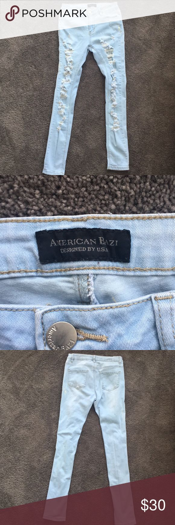 American Bazi light washed jeans NWOT American Bazi high wasted, light washed jeans with ripped all throughout the front of the jean. Never worn. Just too big on me. The tag says they are a 3. i'm a 2 and they fit like a 3/4. American Bazi Jeans Skinny