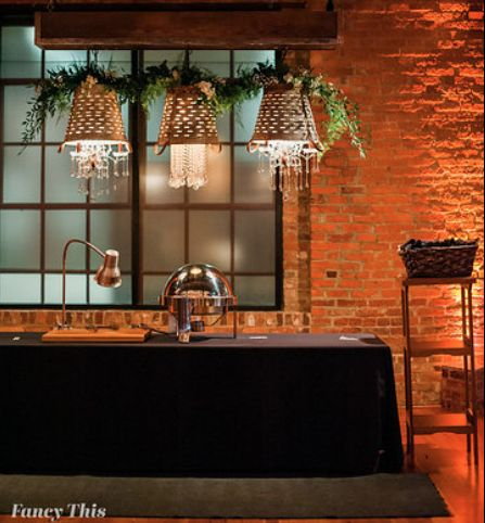 Meet Liza, Get Lit's custom shabby chic 3 olive bucket chandeliers, dripping with crystal. Photo by Fancy This.  Greenery by English Garden. Southern Bride and Groom vendor appreciation event at Angus Barn, Bay 7, 2018