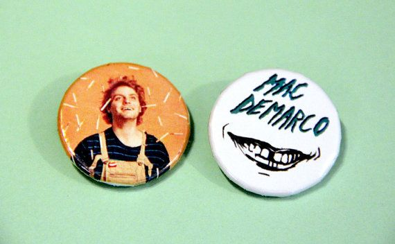Your favorite cigarette smoking teen idol who can never seem to keep his clothes on made into a button, now as a pair! These sweet buttons