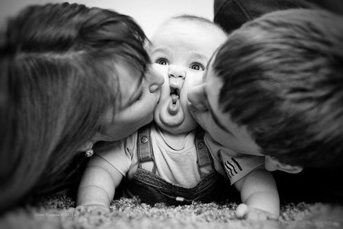 Austin's first birthday photo?  With the girls kissing him?