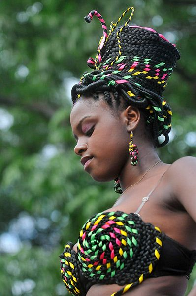 Cali, Colombia: A young woman exhibits her intricately designed hairstyle during the eighth Afro hairstyle contest.