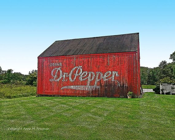 Old red barn photo with Dr Pepper painted on the side. A bright, colorful print with red paint, green grass, blue sky, and a cheerful country home feeling. This print is now available on my Etsy shop at www.etsy.com/shop/AnneFreemanImages  I ship worldwide.  Click on the link for print details and to order.   ~ Anne Freeman Images ~ Prints to Make you Smile ~  Dr Pepper Barn  Barn Wall Art  Barn Wall by AnneFreemanImages