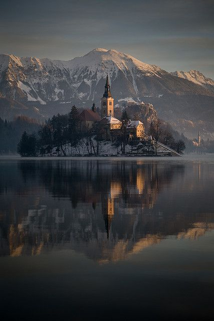 Lake Bled, Slovenia. Perched atop a steep cliff rising 130 metres above the glacial Lake Bled is a symbol of Bled and Slovenia – Bled Castle. If you don't already know that Lake Bled is the most popular tourist attraction in Slovenia you'll know it the moment you arrive.