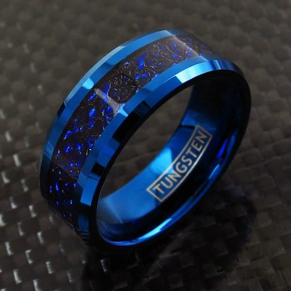 A sharp black Celtic dragon against a cobalt blue background in a cobalt blue tungsten ring. Beautiful, intricate, and complex. Wholesale Tungsten Rings | Wedding Bands. http://www.925express.com