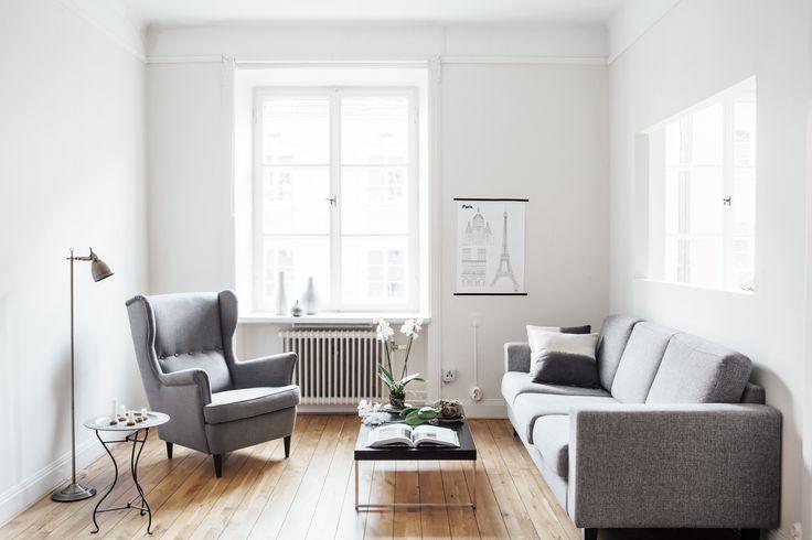 Odenplan vardagsrum trägolv soffa fotölj paris