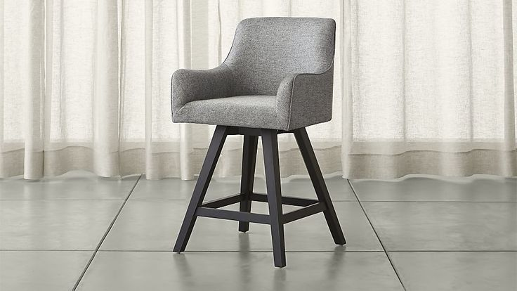 Sculpted for comfort and ready for fun, this upholstered stool puts everyone at ease. Styled contemporary and clubby, Harvey encourages relaxing with a swivel seat that makes it easy to get in and out.
