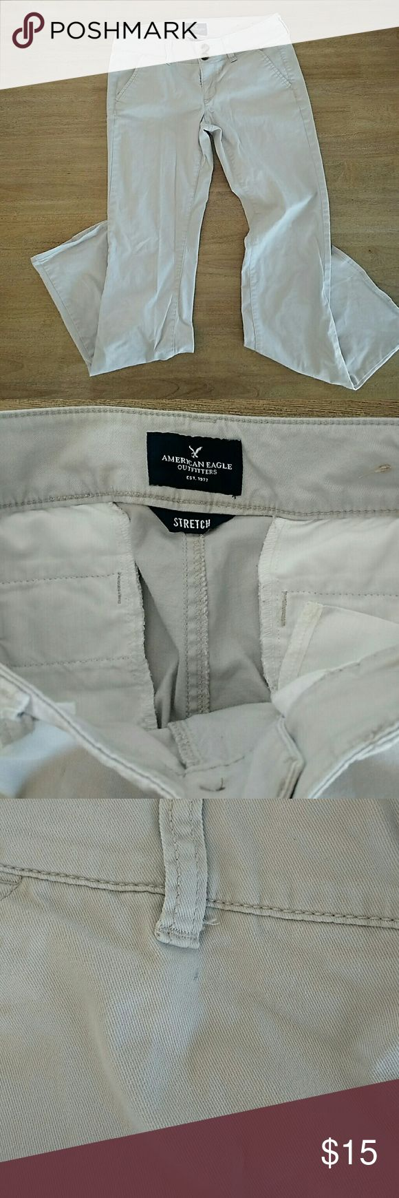 "American Eagle khakis Good shape! Boot cut, stretch. Great for work. Tiny pen mark by one belt loop. Size 0. 30.5"" inseam. American Eagle Outfitters Pants Trousers"