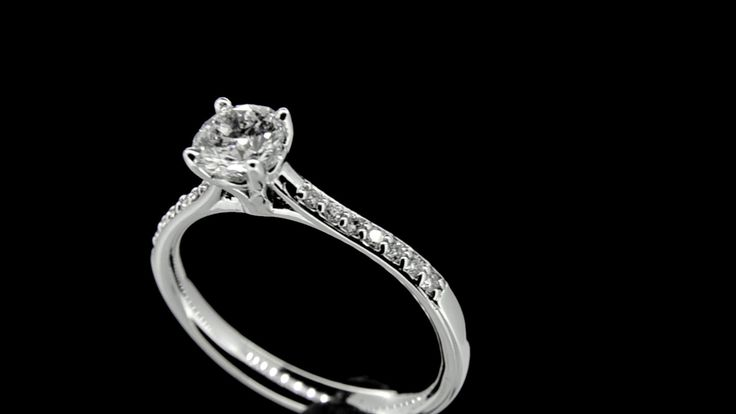 'CAITLIN' -- Custom Made Solitaire set with Oval Diamond with Diamond Accent Shoulders in 18ct White Gold. Diamond Wt. 0.51 carat.