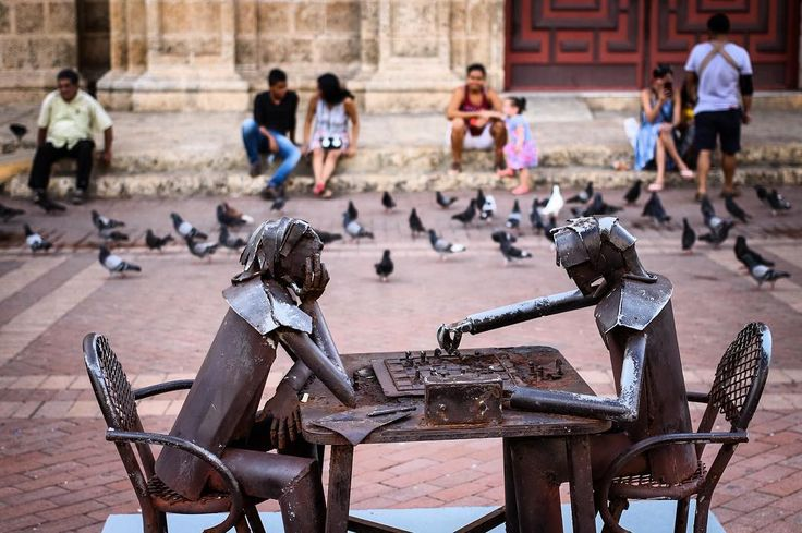 """""""Eternally playing chess"""". These metal chess players sit in a square in the historical center of Cartagena de Indias in #Colombia. There were also other sculptures made out of scrap metal on the square. Made out a fun scene with people sitting all around."""