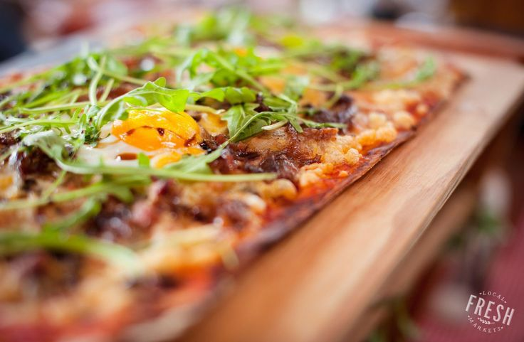 A beautiful breakfast pizza from Ciao Bella at the Earth Fair Market in Tokai, Cape Town.