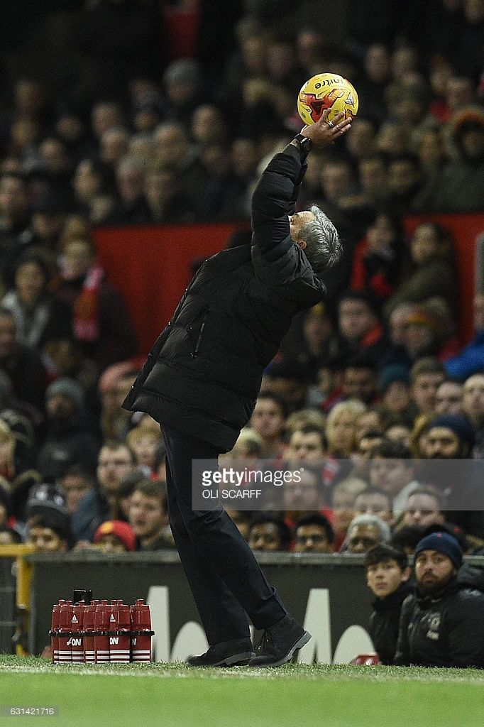 Manchester United's Portuguese manager Jose Mourinho streches to catch a stray ball during the EFL (English Football League) Cup semi-final football match between Manchester United and Hull City at Old Trafford in Manchester, north west England on January 10, 2017. Manchester United won the match 2-0. / AFP / Oli SCARFF / RESTRICTED TO EDITORIAL USE. No use with unauthorized audio, video, data, fixture lists, club/league logos or 'live' services. Online in-match use limited to 75 images, no…