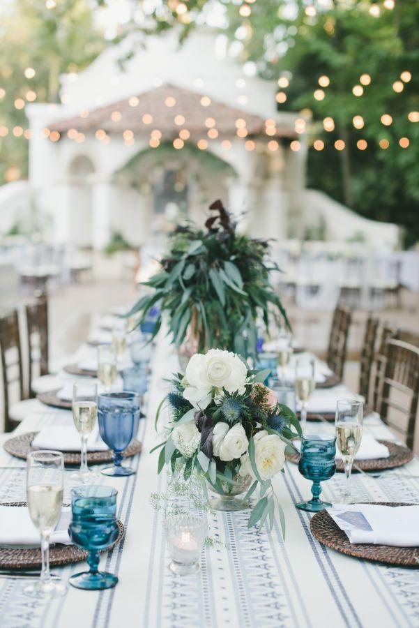 Bohemian style wedding table decor: http://www.stylemepretty.com/little-black-book-blog/2016/11/30/blue-bohemian-summer-california-wedding/ Photography: One Love - http://www.onelove-photo.com/