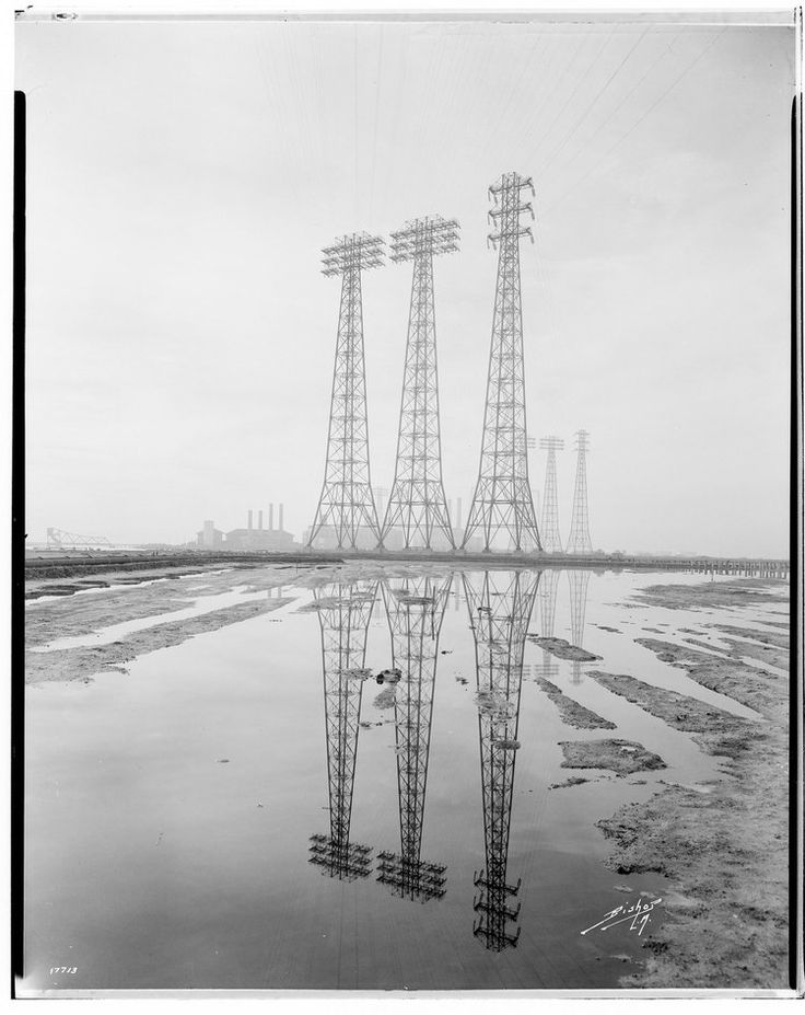 Long Beach-Lighthipe-Laguna Bell Transmission Line, Tall crossing towers at Long Beach, complete towers with reflection in water, G. Haven Bishop, 1932