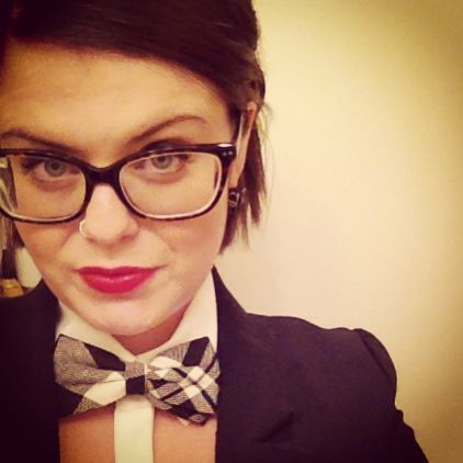 Lady bow tie, red lips, glasses, Tiffany necklace.