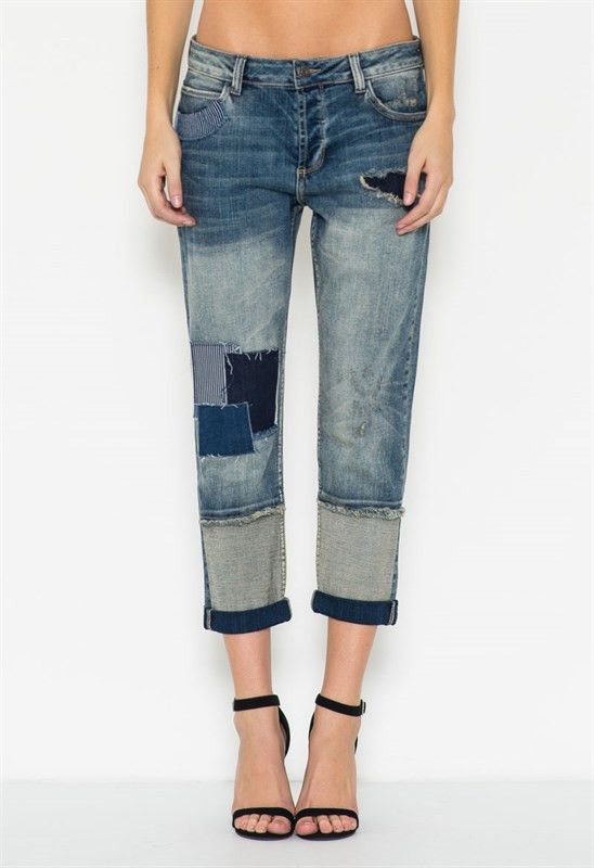 Designed for both comfort and style, this boyfriend jean is the ultimate win. Relaxed fit and an untacked cuffed hem for a slouchy look. Finished with destroyed detail mended with patches. 99% cotton/
