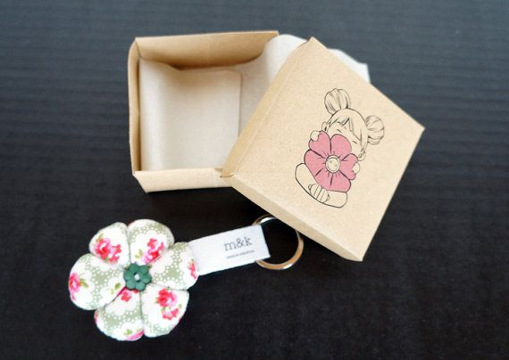 Handmade illustrated box with a soft flower inside