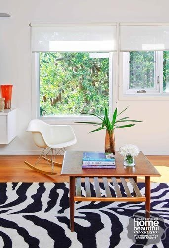 A white Eames rocking chair from Living Edge takes pride of place in this living room.