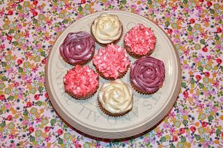 Chai latte cupcakes piped with violet, pink and cream vanilla buttercream flowers!