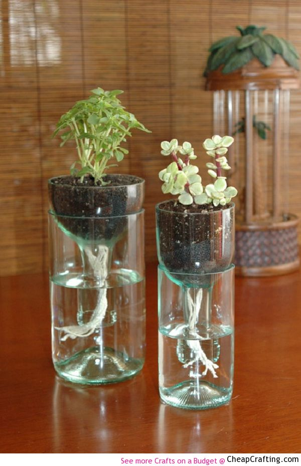 Would love to make it...not sure if I have to courage to pull it off - I need a pyro in my life to help with this one! Self Watering Recycled Wine Bottle Planter How To