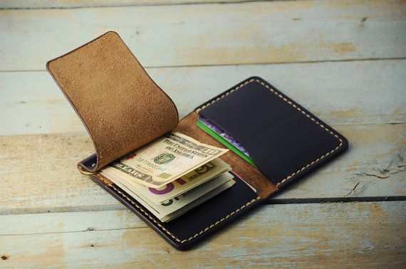 Leather money clip wallet has the cover on left side under which is a metal flip for cash from all currencies bills. And under it is another hidden pocket for more cash or other items, cards, etc. Bifold wallet hold at least 2 - 3 cards in each pocket and it will mold to fit more stuff over break in period. This leather money clip wallet made from Legendary Horween leather called Chromexcel #8 sourced in the US. Dimensions: closed approx 8.5 cm x 11.5 cm (3.3  x 4.5 ).  Thickness of leather…