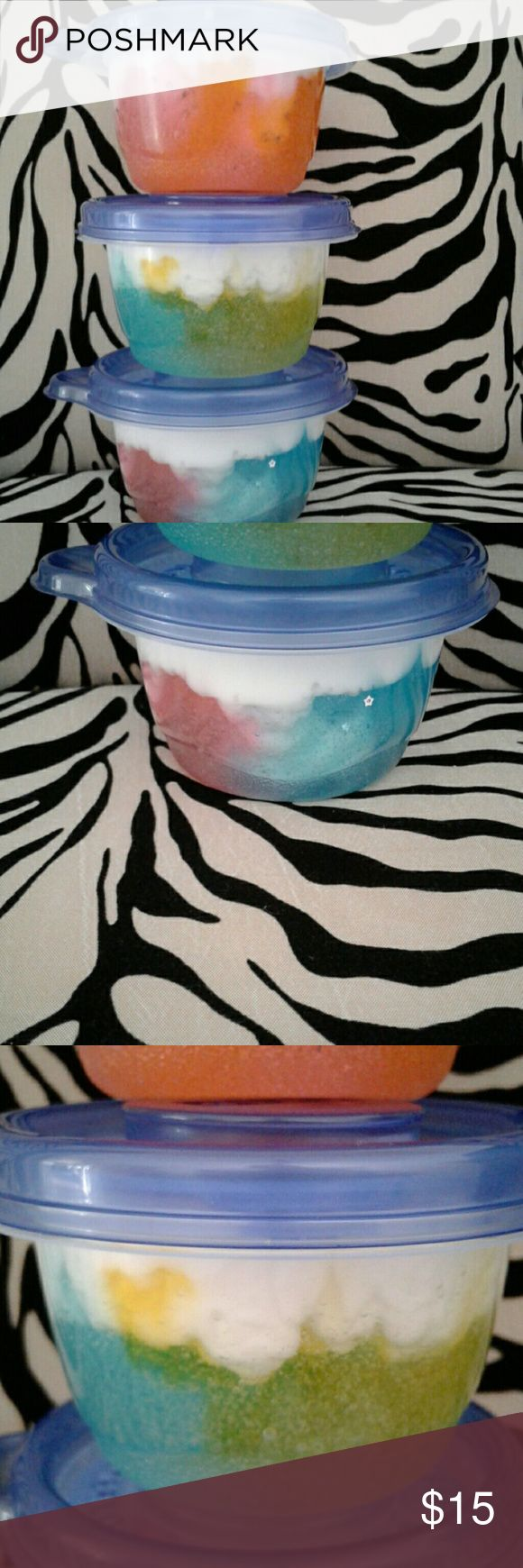 Avalanche slime Duo 4 ounce container of avalanche slime the first Avalanche slime is orange and pink with silver stars the second one is yellow and green with no Glitter and the last one is is a blue and pink with silver Other