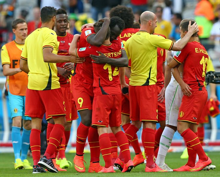 Belgium Rallies Past Algeria 2-1 To Pass First World Cup Test - BELO HORIZONTE, BRAZIL - JUNE 17: Belgium players celebrate victory in the 2014 FIFA World Cup Brazil Group H match between Belgium and Algeria at Estadio Mineirao on June 17, 2014 in Belo Horizonte, Brazil. (Photo by Quinn Rooney/Getty Images)