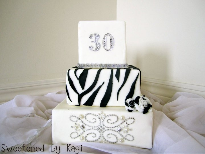 I designed this cake for someone very special's 30th birthday party! I wanted to design the cake with a  zebra print to go with the party theme but at the same time I wanted to keep the design chic and elegant! This cake was covered in fondant and embellished with crystals and pearls!    http://sweetenedbykagi.blogspot.com/2011/07/zebra-bling-cake.html