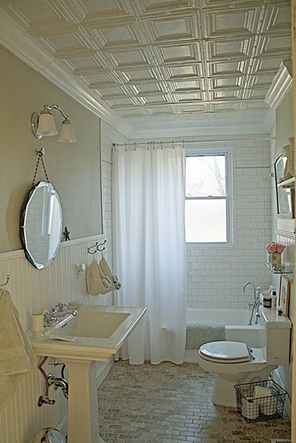 i love the idea of a tin ceiling and crown molding in the bathroom...good way to brighten up the hall baths that don't have windows