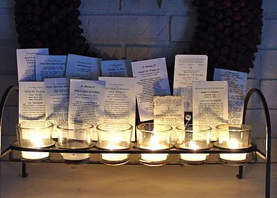 And All Soul's Day - vigil candles with the funeral cards of loved ones