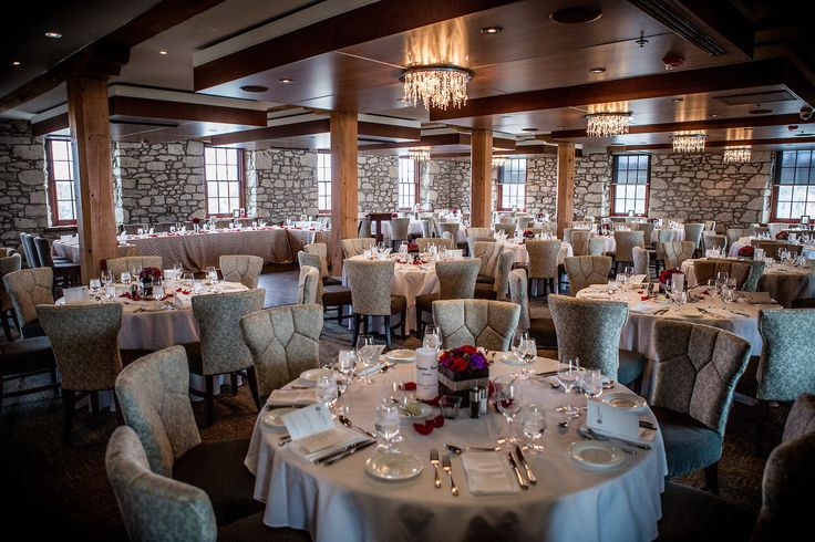 Wedding venues, round tables, red and purple centerpieces, Table setting, Elegant, Stone, Woodbeams,  Cambridge Mil, Cambridge, Ontario, Canada wedding photography experts | Anne Edgar Photography